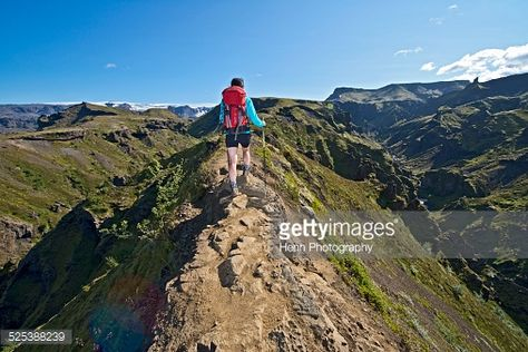 Woman hiking up to Fimmvordurhals Pass above Thorsmork Valley, Thorsmork, South Iceland, Iceland : Stock Photo