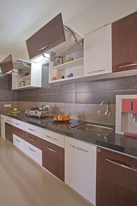 The L Shaped Kitchen Layout Is A Standard Design For Home Kitchens The L Shape Layout Was Dev Kitchen Modular Interior Design Kitchen Modular Kitchen Cabinets