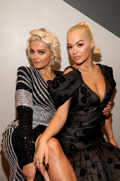 Bebe Rexha (L) and Rita Ora attend the 2018 American Music Awards VIP Lounge, presented by Aviation American Gin, at Microsoft Theater Gold Ballroom.