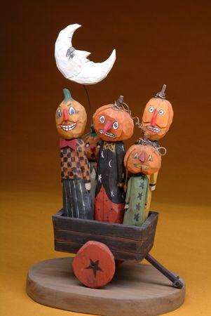 Halloween Wood Carvings. Harvest. Pumpkins in a cart