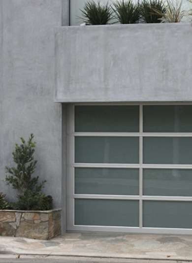 Glass Paneled Garage Doors For A Contemporary Look Consider A Garage Door That Features Clean Lines And Translucent Glass Panel Garage Doors Garage Door Panels Garage Door Design