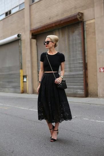 Dressy casual.  Slight crop top, full mid skirt and strappy sandal heels pulled together with a cross-body and a chignon.  Elegant, stylish and comfortable for date night.