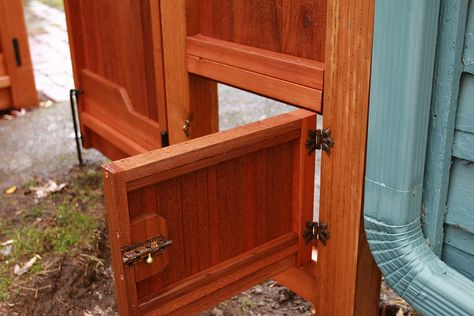 Craftsman fence with a doggie door!