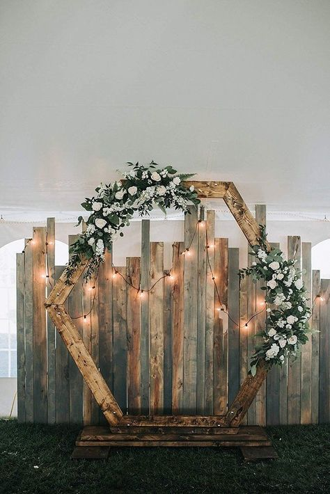 36 Rustic Wedding Decor For Country Ceremony rustic wedding d cor hexagon shaped backdrop with greenery roses and lightbulb dorothy renzi weddingforward wedding bride rusticwedding rusticweddingdecor Rustic Wedding Alter, Rustic Weddings, Outdoor Weddings, Indian Weddings, Romantic Weddings, Beach Weddings, Outdoor Diy Wedding Decor, Outdoor Decor, Country Wedding Arches