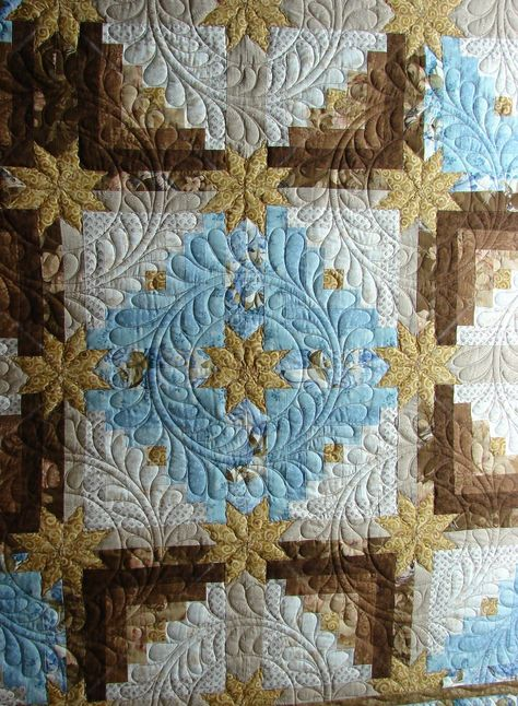 Log cabin stars quilt, quilted by Quilt vine, feather wreath designs