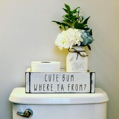 """Cute bum. Where ya from! These bathroom boxes are perfect for the back of that hard to decorate toilet. I don't know about you, but I've never found the right sized basket and it has always annoyed me...until now. Funny AND functional=double win. It will hold 2 large rolls of toilet paper side by side or do as pictured and add a painted mason jar to your order! The box measures 11.5""""l x 7""""d x 3.5""""h. Please measure your porcelain throne before ordering because size matters and I do not .."""