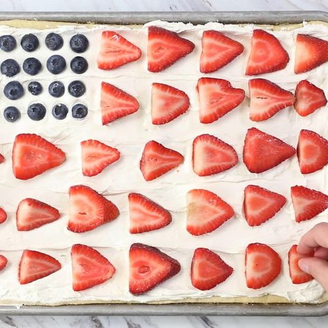 The BEST summer dessert that's topped with fresh fruit and has a soft sugar cookie crust. Super simple to make and always a hit. You'll absolutely love this easy fruit pizza! #fruitpizza #sugarcookies #dessert #summerdessert #patriotic #4thofjuly #fourthofjuly #berries #fruit #fruitdessert #recipes #video #videorecipes #recipevideo #foodvideo #dessertvideo #iheartnaptime