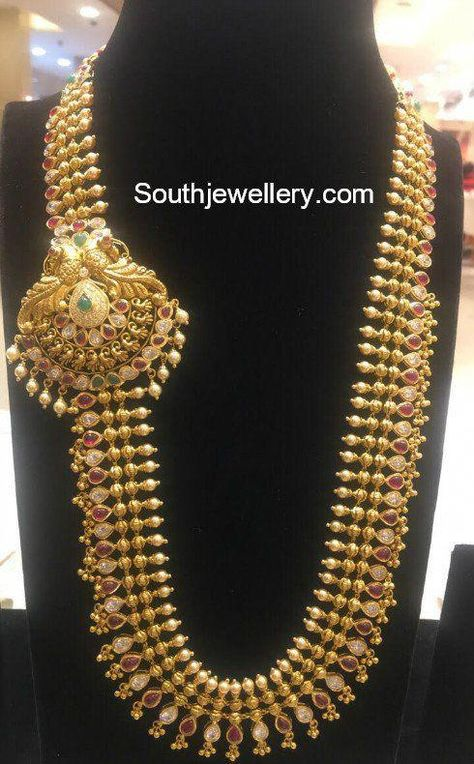 22 carat gold antique haram with peacock side pendant studded with cz stones, pota rubies and emeralds by Swarna kanchi Jewellers, Kothapet, Hyderabad.