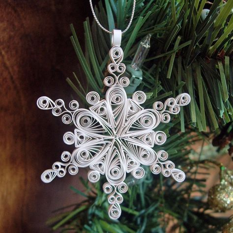 A snowflake ornament is made from eight V-shaped strips of paper, curled at the ends with a quilling needle and joined with a dot of glue at the center. Description from pinterest.com. I searched for this on bing.com/images