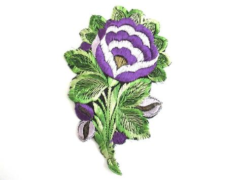 An antique purple silk flower applique vintage floral patch