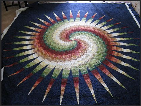 "This quilt called ""Spiky Bargello"" (quilted by Libby) is so striking! We love how it moves around the swirl."