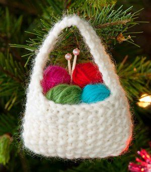 Yarn Basket Ornament: Free knitting pattern from Red Heart Yarn. Incredibly fast project that's perfect as a gift topper or as the gift itself! Just in time for the Holidays. Knitted Christmas Decorations, Knit Christmas Ornaments, Crochet Ornaments, Christmas Crafts, Christmas Presents, Holiday Decorations, Easy Ornaments, Christmas Baskets, Homemade Christmas