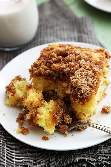 Sour cream makes this coffee cake super moist and the best part is that it starts with a cake mix. It's so easy to make, and loaded with a double layer of cinnamon crumbly goodness. This breakfast cake is an instant crowd pleaser!