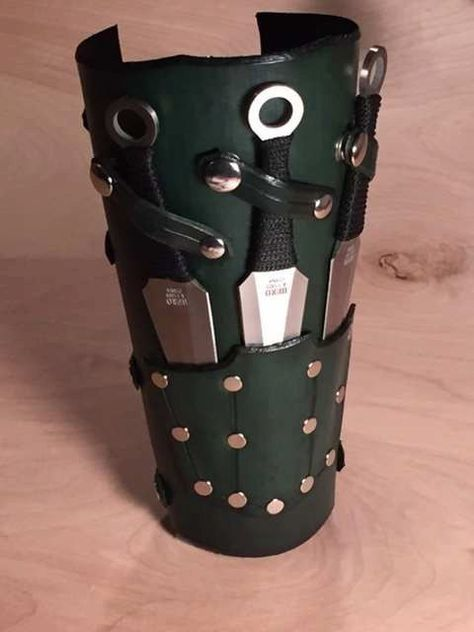 Leather Bracer with Throwing Knives by OwlVsOctopus on Etsy *Knives only on under side and blended in as much as possible so as to go unnoticed