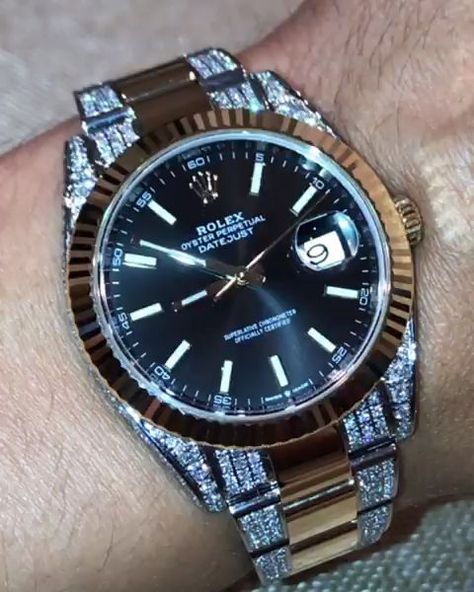 silver rolex watch with diamonds band make sure it has an automatic movement instead of a quartz movement make sure it has a good weight