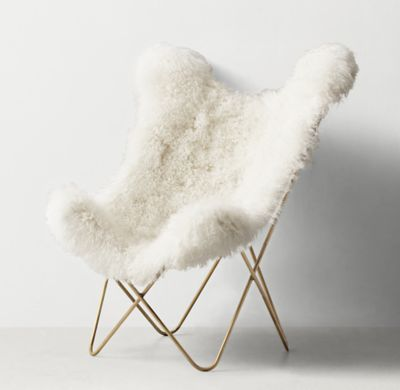 RH TEEN's Tye Mongolian Lamb Butterfly Chair - Light Aged Brass:Inspired by the 1930s iconic original, our interpretation features a comfortable sling seat, sculptural frame and removable slipcover in silky Mongolian lamb.