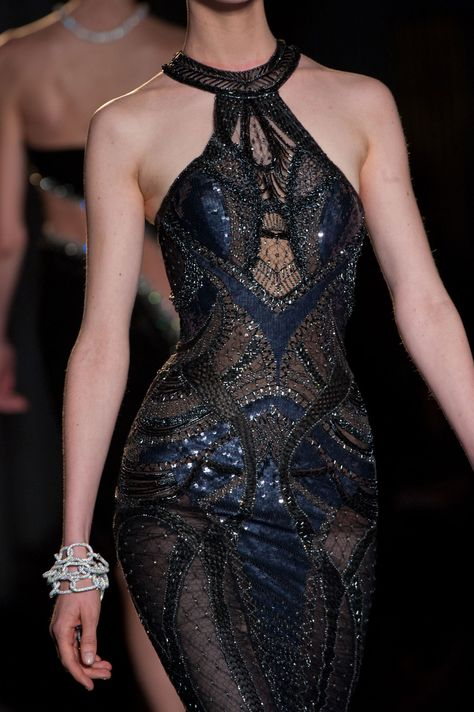 This is a Versace dress, and while I wouldn't feel confident in it, it definitely gives that stick figure model some va-va voom curves!