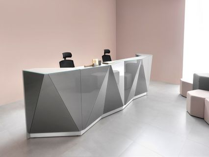 The Shape Of This Modern Reception Desk Casts Light From Different Angles To Create The Centerpiece Modern Reception Desk Reception Desk Reception Desk Design
