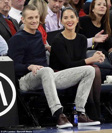 Olivia Munn gets some courtside affection from Joel Kinnaman at the New York Knicks game