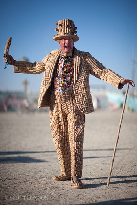 Man wearing a suit made of cork stoppers at the Burning Man Festival. Photography by Scott London - Carefully selected by GORGONIA www.