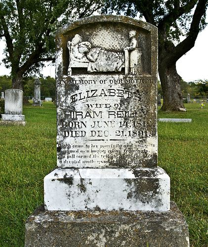Unusual art on a gravestone - the deathbed of the deceased.