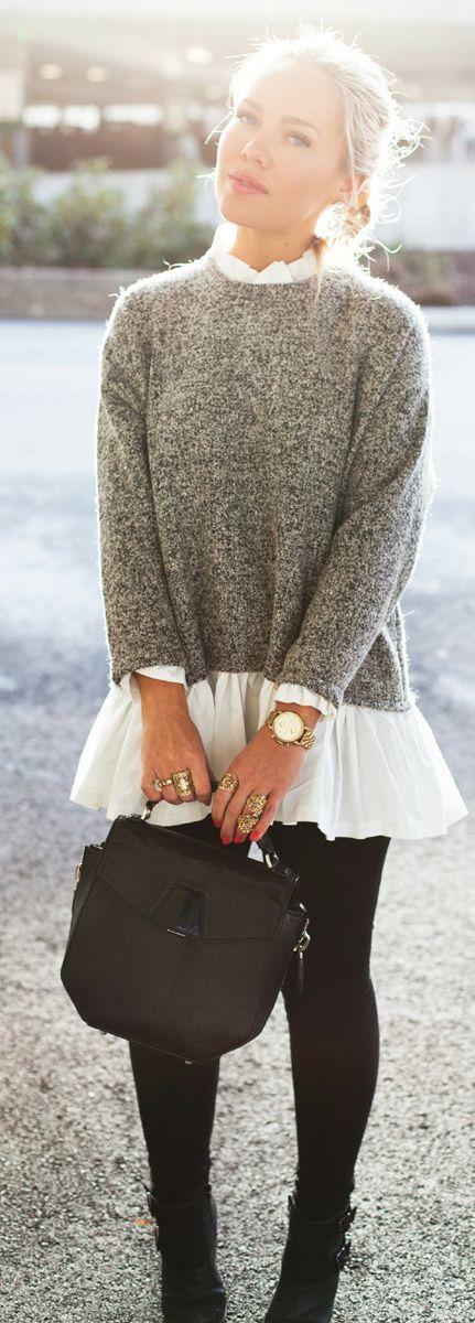 Den Look kaufen: https://lookastic.de/damenmode/wie-kombinieren/pullover-mit-rundhalsausschnitt-langarmbluse-leggings-stiefeletten-satchel-tasche-uhr-ring/8507 — Grauer Pullover mit Rundhalsausschnitt — Weiße Falten Langarmbluse — Goldene Uhr — Goldener Ring — Schwarze Satchel-Tasche aus Leder — Schwarze Leggings — Schwarze Leder Stiefeletten