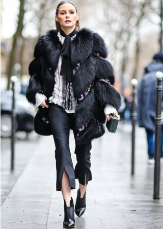 Olivia Palermo wears a black fur coat outside the Giambattista Valli show during Paris Fashion Week Womenswear Fall/Winter on March 6 2017 in Paris Supernatural Style