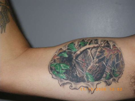 Camo tattoo My tattoo, done at Sacred Arts in North Bay Ontario Rate of pictures of tattoos, submit your own tattoo picture or just rate others