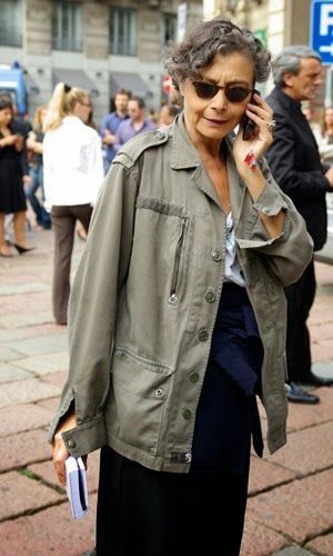 Renata Molho sporting a military coat and accents of indigo and blue.