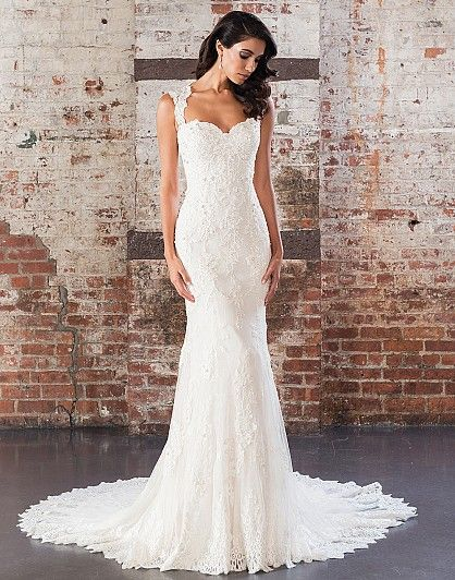 Show off your figure in this tulle and Jersey fit and flare gown with a Queen Anne neckline, sequin beaded cotton lace appliqués over point d'esprit lace, low illusion back, finished hem lace, and buttons to end of the chapel length train.