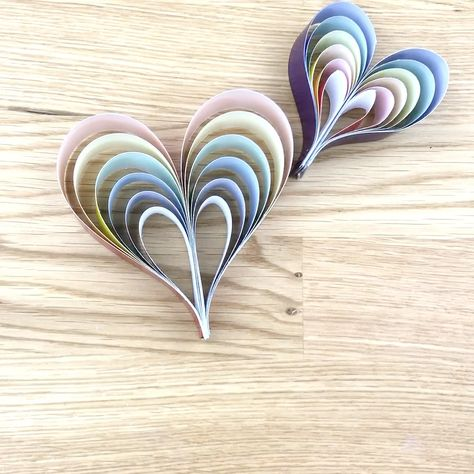 Comes with a 12 page teacher copy and a coloring page style printable too! This simple rainbow paper heart craft is great for preschoolers. You can use them to decorate a classroom, a play room, or just to give to friends! #twitchetts