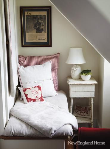 Don't let under the stairs go to waste. Reading nook a great idea, especially if that is storage under the bench.  From NE HOME MAGAZINE