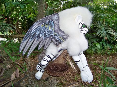 This white liger woodbaby was made by the Midsummer Knights Dream. His head wi.