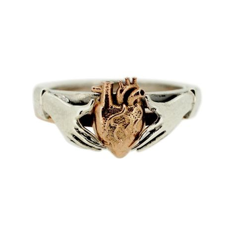 "The Anatomical Heart & Claddagh Rings are a stunning set and a charming testament to love. Exquisitely handcrafted in sterling silver and 9kt rose gold, these two rings can be worn separately or stacked together. Claddagh rings are a traditional Irish design from the 17th century representing love, loyalty, and friendship. They form part of a group of European finger rings called fede rings deriving from the Italian phrase ""mani in fede"" meaning hands joined in loyalty/faith. Fede rings date"