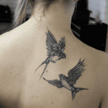 How Gorgeous Are These Two Swallows Flying Around Their Owner S Back Tattoo Sin Flying Gorgeous Owners Sin Swallows Back Tattoo Neck Tattoo Tattoos