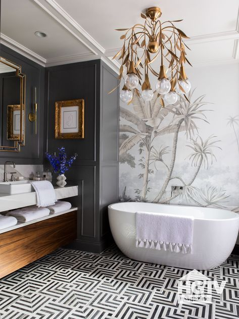 Patterned tile flooring, golden accessories and a white tub make this black and white bathroom shine. See more on HGTV.com.