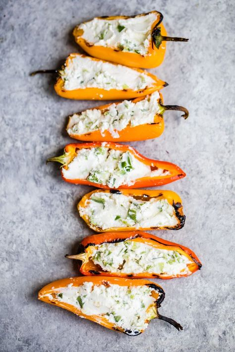 Grilled stuffed mini peppers that are both easy and delicious. This vegetarian appetizer is made with only 3 ingredients -- goat cheese, jalapeños and mini peppers! Grilled stuffed mini peppers that are both easy and delicious. This vegetarian a. Vegetarian Appetizers, Appetizer Recipes, Vegetarian Recipes, Cooking Recipes, Healthy Recipes, Vegetarian Grilling, Ham Recipes, Delicious Recipes, Healthy Grilling