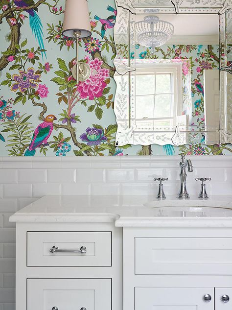 This is excellent. The paper might not be to everyone's taste but it really illustrated the flexibility of white metro tiles. So many ways to style a room!