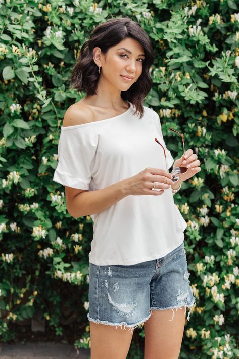 Sightseeing Top in White DETAILS: The oversized fit brings a comfortable and casual feel, while the wide neck shows off your shoulder for a fun and flirty feel. Pair this with shorts and strappy sandals for a cute summer look.Lightweight + Stretchy MaterialCan Be Worn On & Off The Shoulder95% Rayon, 5% Spandex Made In USARelaxed Fit