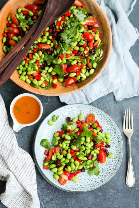 This Edamame Bean Salad combines big flavours and bright colours to make a perfect vegetarian side dish or salad for a potluck. Made with an asian-style dressing and loaded with veggies, this is sure to be a fast favourite. #edamame #edamamesalad #beansalad #vegetarian #heynutritionlady