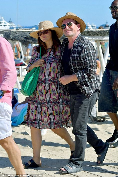Happy together: Bono and Ali looked more in love than ever, and strolled happily…