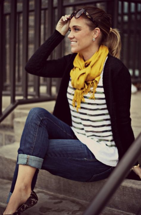 Rolled skinny jeans, striped shirt, cardigan with bright scarf + loafers.
