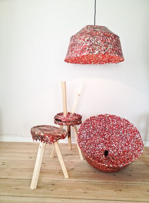 A series of lamps and stools made out of plastic in a simpel and naive upcycled process. The small plastic pieces melts on the inside of the metal mould, and gives the lamp the random melted dots on the surface.