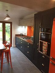 Striking Splashes Of Bright Orange In A Traditional Two Tone Door Kitchen  Recently Inspected In Chelmsford