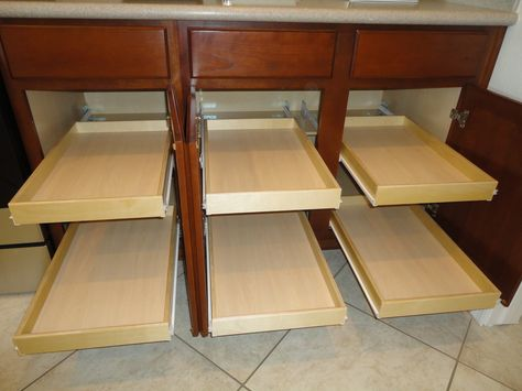 Brackets allow full depth pull out shelves in lower cabinets with half shelf in the middle slideoutshelvesllc.com