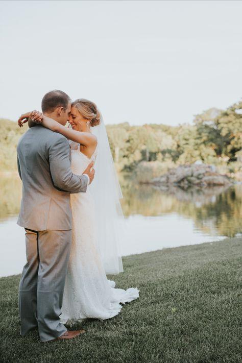 Wedding day photo of the bride and groom at lakeside wedding venue in NJ | Photo: Lily Szabo #njweddingvenue #weddingvenue #brideandgroom #brideandgroomphotos #weddingday #weddingdayphotos #lakefrontwedding #rockislandlakeclub
