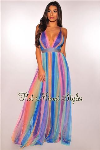 086dd89a6d50 This unicorn inspired maxi dress features a gorgeous multi color print, two  inner slits and adjustable halter straps.