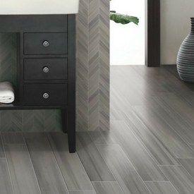 Hardwood Flooring Vs Tile Planks That Look Like Hardwood Pros And Cons Wood Look Tile Living Room Grey Flooring