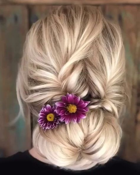 Gorgeous Updo decorated with fresh flowers.