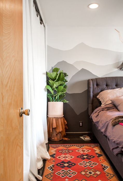 A mountain mural in the master bedroom